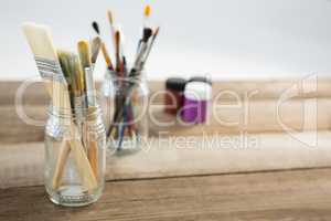 Various paintbrush in glass jar