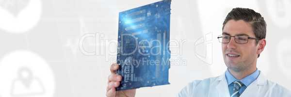 Composite image of computer engineer holding motherboard