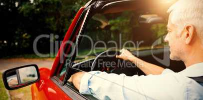 Mature man driving cabriolet