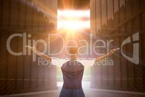 Composite image of football player celebrating with arms stretched 3d