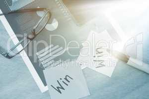 Win written on sticky note with marker spectacles and graph