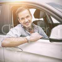 man smiling at camera in a car