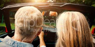 Rear view of mature couple going for ride together