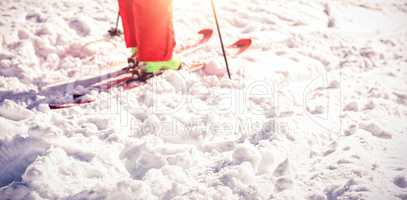 Low section of skier on snowy field
