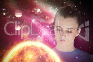 Composite image of close up of beautiful woman meditating 3d