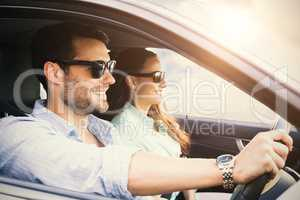 couple in a car smiling