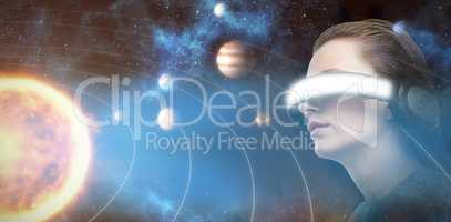 Composite image of low angle view of woman trying virtual reality 3d