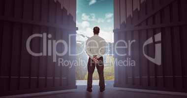 Composite image of businessman turning his back to camera 3d