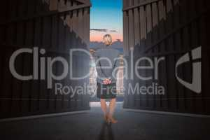 Composite image of businesswoman standing with hands behind back 3d