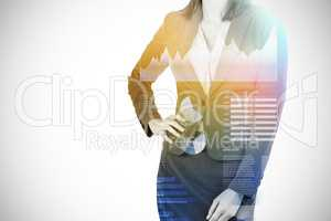 Composite image of midsection of businesswoman with hands on hip 3d