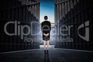 Composite image of young businesswoman standing with hands behind back 3d