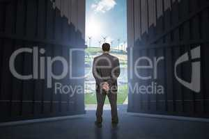Composite image of rear view of classy businessman posing 3d