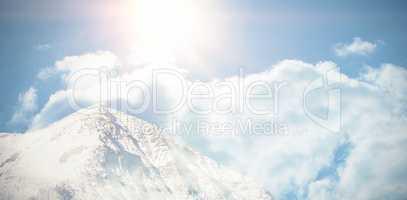 Mountain top against clear blue sky