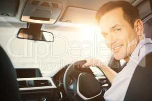Men driving a car