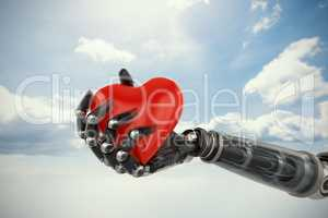 Composite image of three dimensional image of cyborg holding red heart shape decoration 3d