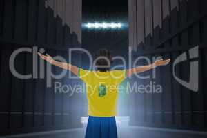 Composite image of football player cheering with arms stretched 3d