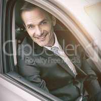Man sitting in a car looking at camera