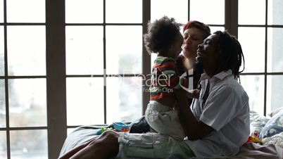 Happy diverse family and son relaxing at home