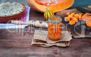 Pumpkin juice in a glass jar on a table