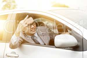 Rude driver showing middle finger