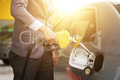 Man pumping fuel