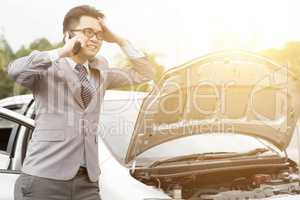 Business man with broken car
