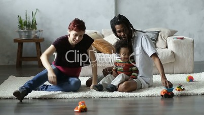 Happy interracial family playing with car toys