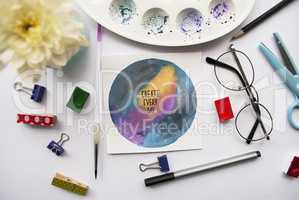 Inspirational quotes on space background. Artist s workspace with white chrysanthemum, glasses, watercolor, pencil, brush, scissors, miniature clothespins on a white background.
