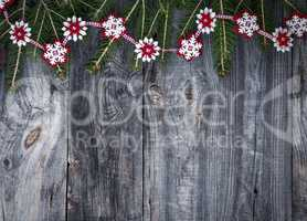 Festive garland of fir branches and decorative felt snowflakes