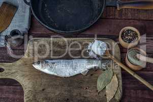 Frozen fish smelt on a kitchen cutting board
