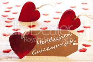 Label With Many Red Heart, Herzlichen Glueckwunsch Means Congratulations