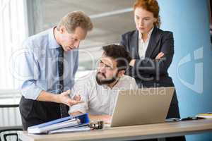 Angry boss screaming at workers