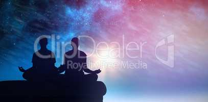 Composite image of attractive couple in white meditating in lotus pose