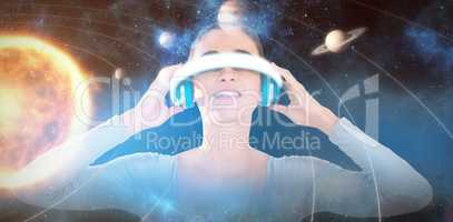 Composite image of smiling woman using virtual video glasses 3d