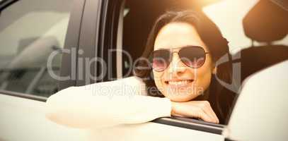 Woman wearing sunglasses in her car