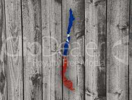 Karte und Fahne von Chile auf verwittertem Holz