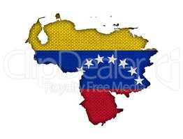 Karte und Fahne von Venezuela auf altem Leinen