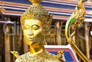 Golden kinnara statue in Grand palace Bangkok,Thailand.
