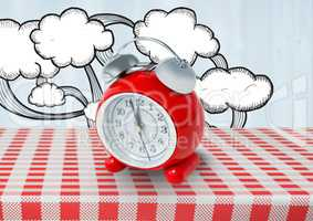 Clock with clouds drawings on red tablecloth