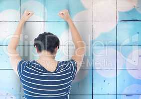 Sad angry woman grief banging fists against a blue wall