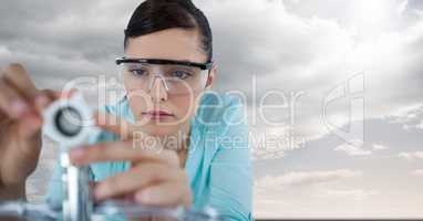 Close up of woman with electronics against sky