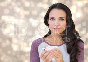 Woman staring straight ahead with white mug against cream bokeh