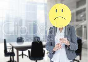 Sad businesswoman against office meeting room