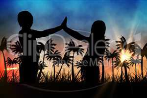 Silhouettes of  kids  against sunset view with palm trees