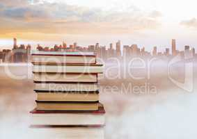 Books stacked by distant city