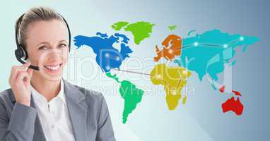 Travel agent with headset against map with lights and blue background