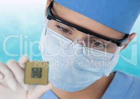 Close up of masked woman with electronics against blue and white background
