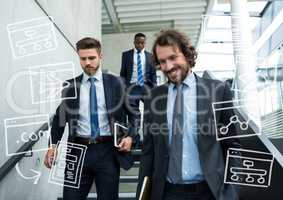 Three business men walking down stairs with white business doodles