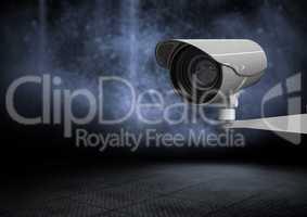 Security camera against dark background