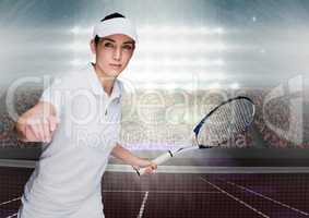 Tennis player on court with bright lights and audience
